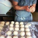 Baker prepares bread rolls Stock Photos