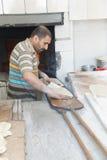Baker prepares flatbread Stock Photography