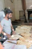Baker prepares flatbread Royalty Free Stock Photo