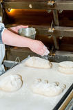 Baker preparing bread. Before  baking Stock Image