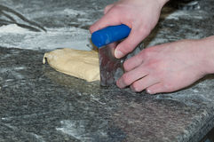 Baker preparing brioche dough. In bakery workshop Stock Photos