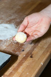 Baker preparing brioche with sugar Stock Photo