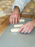Baker preparing chocolate croissant. Baker preparing french chocolate croissant Royalty Free Stock Photography
