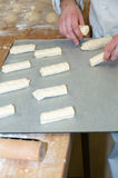 Baker preparing chocolate croissant. In workshop bakery Royalty Free Stock Photo