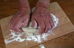 Baker preparing some dough ready to bake some bread Royalty Free Stock Photography