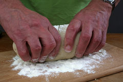 Baker preparing some dough ready to bake some bread.  royalty free stock image