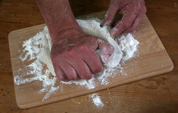 Baker preparing some dough ready to bake some bread.  stock photography