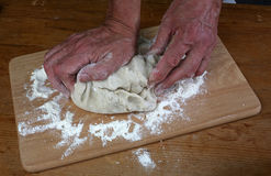 Baker preparing some dough ready to bake some bread Stock Photography