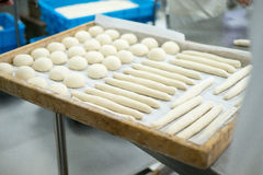 Baker Prepping Freshly Made dough for Rolls Royalty Free Stock Photos