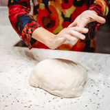 Baker preshapping dough Royalty Free Stock Image