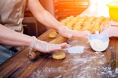 Baker pulls out the dough stock photos