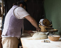 Baker razdelyvet dough for baking bread Stock Photos