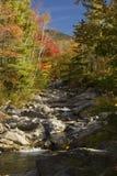 The Baker River flows through fall foliage, Warren, New Hampshir Stock Image