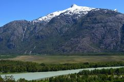 Baker River valley, a glacial river in Southern Chile's Patagonia. The Baker River is a river located in the Aysen Region of the Chilean Patagonia. It is royalty free stock photo