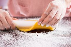 Baker rolling dough Royalty Free Stock Image