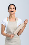 Baker with rolling pin. Passionate baker chef in apron holding a rolling pin stock photos