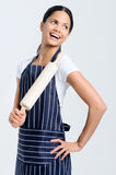 Baker with rolling pin. Passionate baker chef in apron holding a rolling pin royalty free stock photo