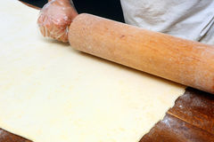 Baker rolls out the dough for cookies Stock Image