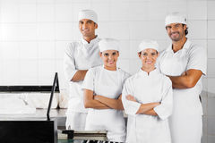 Baker's With Arms Crossed Standing In Bakery Royalty Free Stock Photo