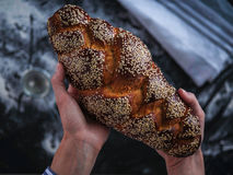 Baker`s hands hold fresh bread Royalty Free Stock Photos