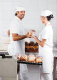 Baker's Packing Bread Loaves In Bakery Royalty Free Stock Photo