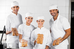 Baker's Showing Packed Breads In Bakery Stock Photos