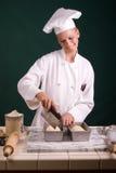 Baker scoring loaf. Passive posed Baker scoring loaf of bread dough in pans Stock Photos