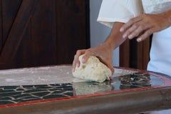 Baker shaping bread Stock Photo