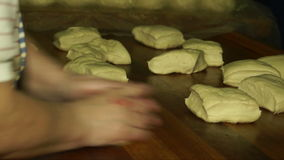 Baker shaping the dough stock video footage