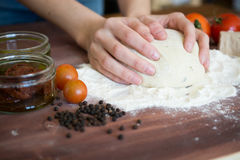 Baker shaping dough Royalty Free Stock Image