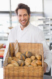 Baker showing basket of bread Royalty Free Stock Photos