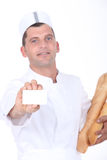Baker showing card Royalty Free Stock Photography