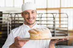 Baker showing a freshly baked loaf Royalty Free Stock Photo