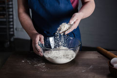 Baker sifting flour Stock Images