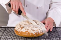 Baker Slices Round Loaf Stock Images