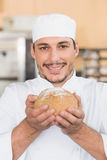Baker smelling a freshly baked loaf Royalty Free Stock Photography