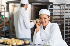 Baker smiling at the camera. In the kitchen of the bakery Royalty Free Stock Photos