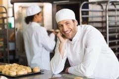 Baker smiling at the camera Royalty Free Stock Photo