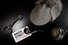 Baker Street Sign And Sherlock Holmes Items On Black Table Stock Photography