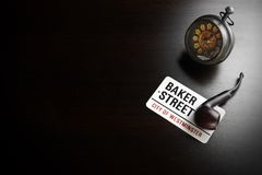 Baker Street Sign And Sherlock Holmes Symbol On Black Table Stock Photo
