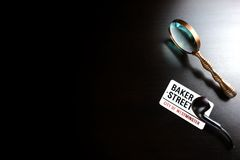 Baker Street Sign And Sherlock Holmes Symbol On Black Table Stock Images