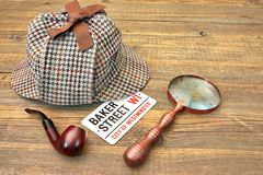 Baker Street Signboard, Sherlock Holmes Cap, Smoking Pipe and Ma Royalty Free Stock Photo