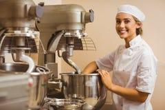 Baker using large mixer to mix dough Stock Images