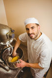 Baker using large mixer to mix dough Royalty Free Stock Images