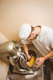 Baker using large mixer to mix dough Stock Photo