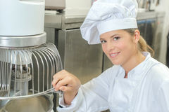 Baker using mixing machine Royalty Free Stock Images