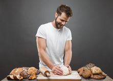Baker with a variety of delicious freshly baked bread and pastry Royalty Free Stock Photo