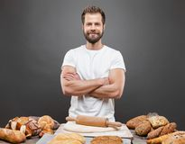 Baker with a variety of delicious freshly baked bread and pastry Royalty Free Stock Photography