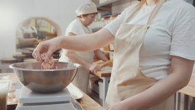 Baker is weighs dough ingredients for baking stock image
