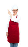 Baker woman pointing towards copy space area Royalty Free Stock Images